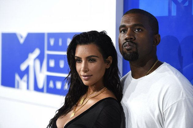 in-this-aug-28-2016-file-photo-kim-kardashian-west-left-and-kanye-west-arrive-at-the-mtv-video-music-awards-in-new-york