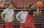 Arkansas assistant coaches Scotty Thurman, left, and TJ Cleveland watch practice Wednesday, Oct. 5, 2016, at Bud Walton Arena in Fayetteville.