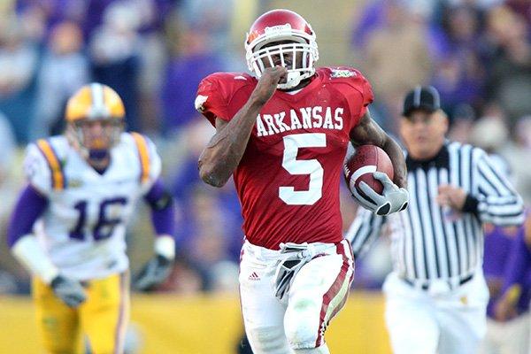 Arkansas running back Darren McFadden runs for a touchdown during a game against LSU on Friday, Nov. 23, 2007, in Baton Rouge, La.