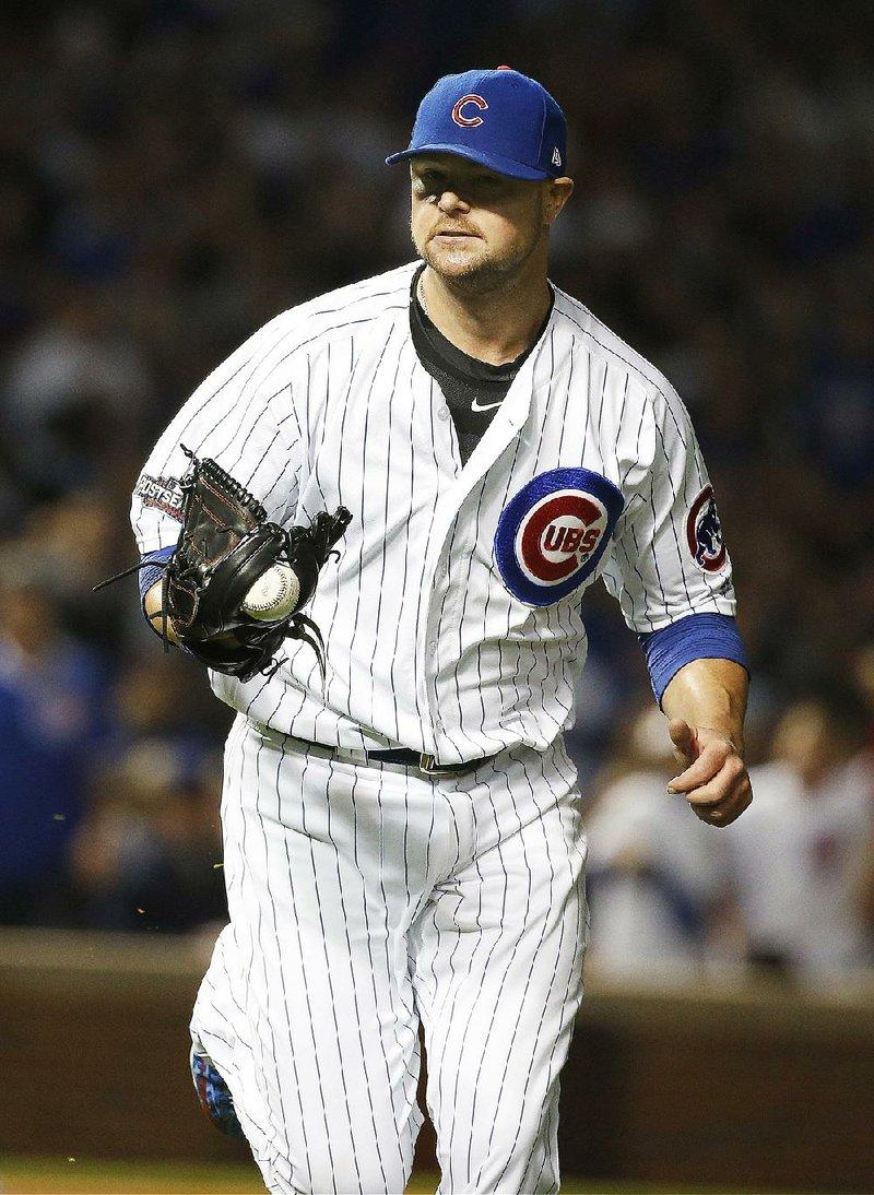 Lester, Baez help Cubs blank Giants in opener