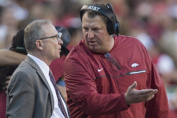 Arkansas football coach Bret Bielema talks with athletic director Jeff Long during Arkansas' game against No. 1 Alabama on Saturday, Oct. 8, 2016.