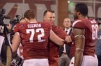 Arkansas coach Bret Bielema hugs offensive lineman Frank Ragnow following the Razorbacks' loss to Alabama on Saturday, Oct. 8, 2016, in Fayetteville.