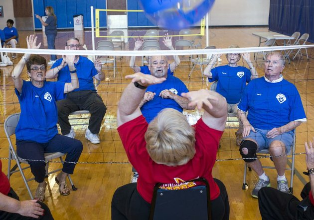 chair volleyball net. chair them on: senior citizens fired up at central arkansas volleyball tournament net f