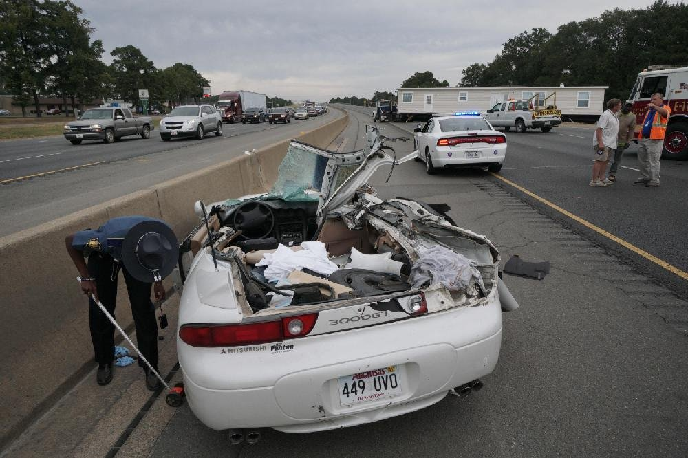 PHOTOS: Trailer takes off roof of car in I-30 crash