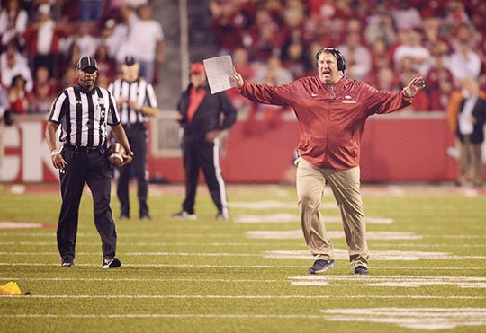 NWA Democrat-Gazette/Ben Goff BEGGING TO DIFFER: Arkansas coach Bret Bielema argues with the officials in the Razorbacks' game against Alabama, drawing a penalty for unsportsmanlike conduct after a penalty negated Austin Allen's touchdown pass to Drew Morgan in the second half of Alabama's 49-30 victory.