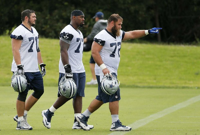 629a2a319d7 Tyron Smith (center) and Travis Frederick (right) have signed lucrative  contracts with the Dallas Cowboys