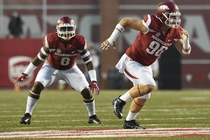 Arkansas defensive end Karl Roesler (96) and linebacker De'Jon Harris (8) run a play during a game against Alabama on Saturday, Oct. 8, 2016, at Donald W. Reynolds Razorback Stadium in Fayetteville.