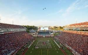 Fighter jets fly over Donald W. Reynolds Razorback Stadium prior to a game between Arkansas and Ole Miss on Saturday, Oct. 15, 2016, in Fayetteville.
