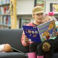 Brittany Daniels reads to her daughter Ava Daniels, 5, both of Lowell, Thursday at the Bentonville P...