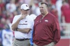 Arkansas secondary coach Paul Rhoads, left, talks with head coach Bret Bielema prior to a game against Ole Miss on Saturday, Oct. 15, 2016, in Fayetteville.