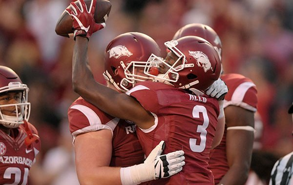 Arkansas receiver Dominique Reed is congratulated after scoring a touchdown during a game against Ole Miss on Saturday, Oct. 15, 2016, in Fayetteville.