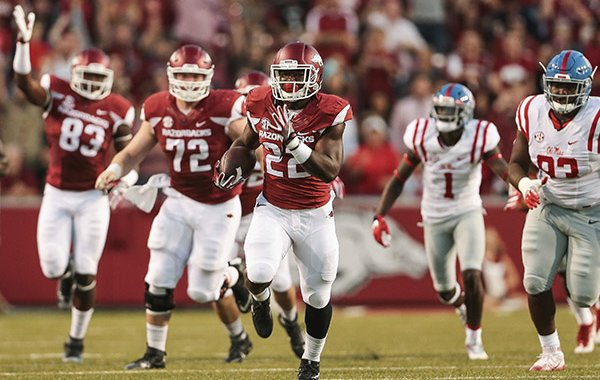 Arkansas running back Rawleigh Williams III (22) carries for a gain during the first quarter of an NCAA football game against Mississippi on Saturday, Oct. 15, 2016, in Fayetteville, Ark. (AP Photo/Chris Brashers)