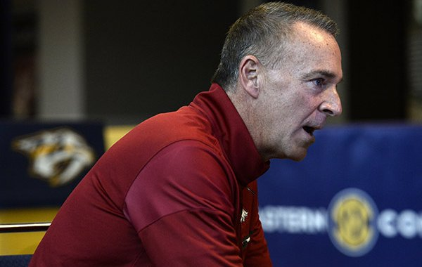 Arkansas coach Jimmy Dykes answers a question during the Southeastern Conference women's NCAA college basketball media day, Thursday, Oct. 20, 2016, in Nashville, Tenn. (AP Photo/Mark Zaleski)