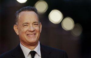 In this Thursday, Oct. 13, 2016 file photo, actor Tom Hanks arrives to receive a lifetime achievement at the Rome Film Festival, in Rome.