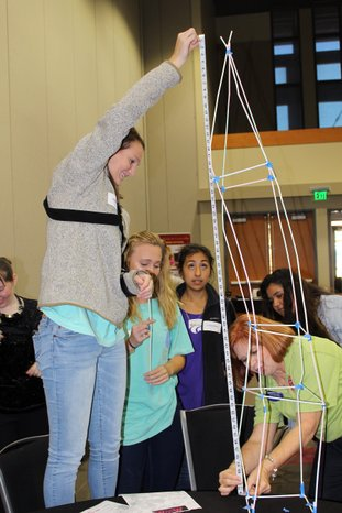 Mentoring to extreme heights: Carolyn Smith, right, science chair for the El Dorado School District, measures a 'World Tower,' created by El Dorado High School students and mentors, during a Million Women Mentors event at South Arkansas Community College. The MWM is a mission of Lt. Gov. Tim Griffin designed to encourage girls to enter STEM (Science, technology, engineering and math) fields and he was the keynote speaker during the kick-off event Friday.