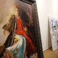 Paintings by Amy Eichler sit ready to be hung Wednesday in one of the large rooms at the Fayettevill...