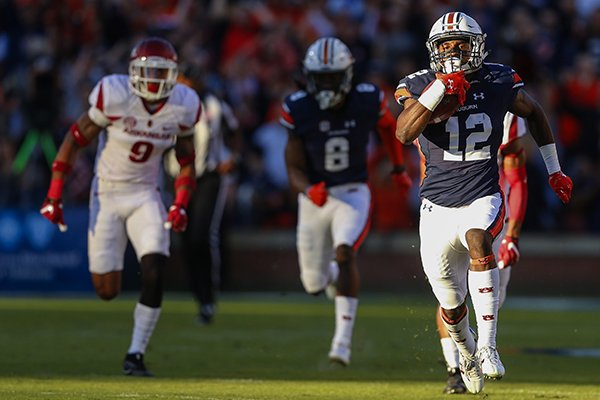 Auburn wide receiver Eli Stove (12) breaks away for a touchdown against Arkansas during the first half of an NCAA college football game, Saturday, Oct. 22, 2016, in Auburn, Ala. (AP Photo/Butch Dill)