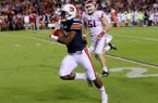 Auburn's Stanton Truitt scores his teams 4th td over Arkansas' during the first second of their game Saturday at Jordan-Hare Stadium in Auburn, Ala.