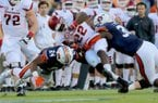 Arkansas' Rawleigh Williams (22) fights for yardage but is brought down during the first quarter of their game Saturday at Jordan-Hare Stadium in Auburn, Ala.