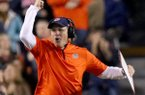 Auburn coach Gus Malzahn celebrates his team's sixth TD in the third quarter Saturday at Jordan-Hare Stadium in Auburn, Ala.