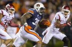 Auburn running back Kamryn Pettway (36) looks to get by Arkansas linebacker Dwayne Eugene (35) (left) and defensive back Santos Ramirez (9) on Saturday, Oct. 22, 2016, at Jordan-Hare Stadium in Auburn, Ala.