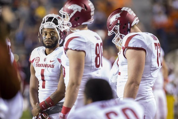 Arkansas Razorbacks wide receiver Jared Cornelius (1) (left) stands on the sideline with teammates on Saturday, Oct. 22, 2016, during the fourth quarter against Auburn at Jordan-Hare Stadium in Auburn, Ala.