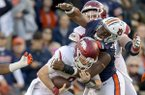 Arkansas quarterback Austin Allen (8) is sacked by Auburn defensive lineman Andrew Williams (79) on Saturday, Oct. 22, 2016, at Jordan-Hare Stadium in Auburn, Ala.
