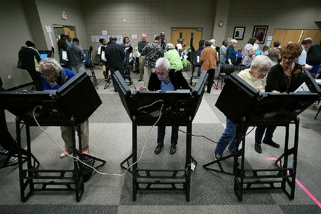 voters-make-their-choices-monday-during-the-start-of-early-voting-at-the-laman-library-in-north-little-rock-some-counties-reported-that-the-number-of-voters-monday-exceeded-the-number-who-cast-ballots-on-the-fi-rst-day-of-early-voting-in-2012-the-previous-presidential-election