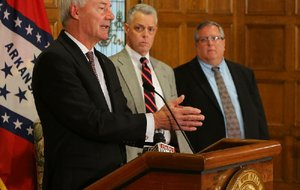 Gov. Asa Hutchinson (from left) explains his plan for War Memorial Stadium at a news conference Tuesday with Kane Webb, state Department of Parks and Tourism director, and Jerry Cohen, War Memorial Stadium Commission executive director.