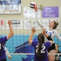 Emily Harris (13) of Rogers sends the ball past Maggie Saad (22) and Lauren Sink (23) of Mount St. M...