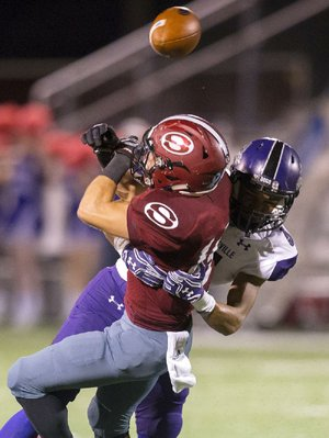 Fayetteville's Trey Coulter breaks up a pass intended for Springdale's Alex Thompson in Fayetteville's 56-7 victory Friday night in Springdale.