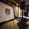 A picture of Michelle Hudson sets to the side of the stage as her mother, Kim Umber with Waco Title,...