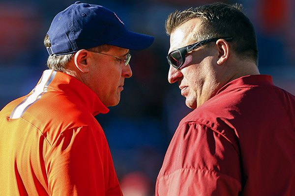 Auburn head coach Gus Malzahn, left, talks with Arkansas head coach Bret Bielema before an NCAA college football game, Saturday, Oct. 22, 2016, in Auburn, Ala. (AP Photo/Butch Dill)