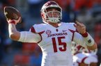 Arkansas quarterback Cole Kelley (15) warms up before an NCAA college football game Auburn, Saturday, Oct. 22, 2016, in Auburn, Ala. (AP Photo/Butch Dill)
