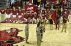 Arkansas basketball players kneel during the playing of the national anthem prior to an exhibition game against Oklahoma Baptist on Thursday, Nov. 3, 2016, in Fayetteville.