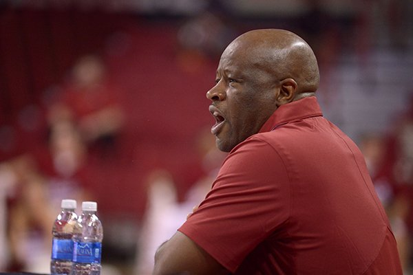 Arkansas basketball coach Mike Anderson watches from the sideline during a scrimmage Sunday, Oct. 23, 2016, in Fayetteville.