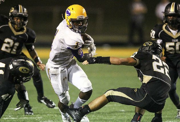 little-rock-catholic-running-back-samy-johnson-middle-breaks-through-a-line-of-little-rock-central-defenders-thursday-during-the-rockets-70-56-victory-over-the-tigers-for-more-high-school-football-photos-visit-arkansasonlinecomgalleries