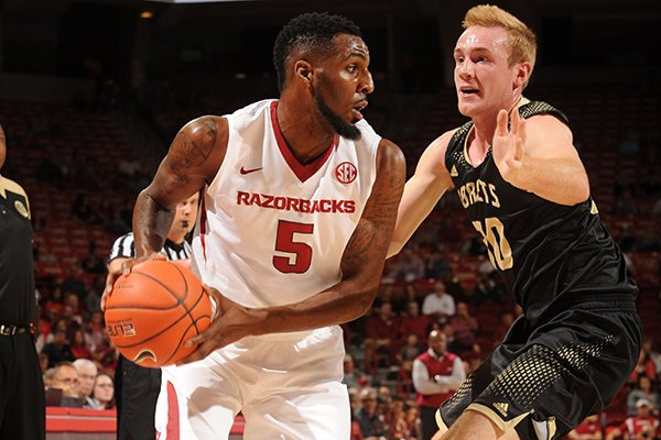 Arkansas' Arlando Cook (5) looks to drive around Emporia State's Josh Pedersen Friday, Nov. 4, 2016, during the first half of play in Bud Walton Arena in Fayetteville.