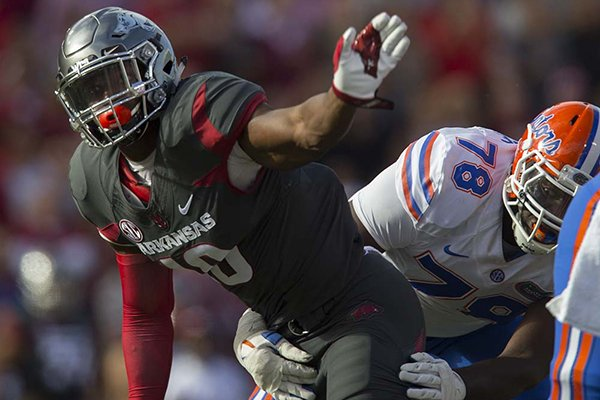 Arkansas defensive end Randy Ramsey sacks Florida quarterback Luke Del Rio during a game Saturday, Nov. 5, 2016, in Fayetteville.