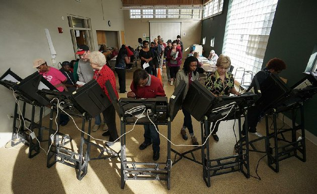 people-cast-their-ballots-in-early-voting-saturday-at-the-williams-library-in-downtown-little-rock-as-of-friday-nearly-500000-arkansans-had-voted-early-the-secretary-of-states-office-said