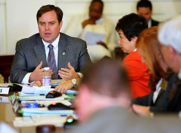 sen-jon-woods-r-springdale-left-is-shown-in-this-file-photo