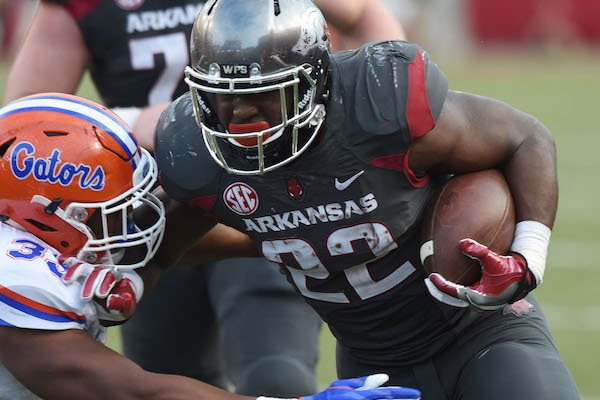 University of Arkansas running back Rawleigh Williams III tries to get past Florida defender David Reese in the 4th quarter Saturday, November 5, 2016 during the Razorbacks 31-10 win at Razorback Stadium in Fayetteville.