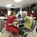 Jackie Shiffen, a University of Arkansas nursing student, takes James Nail's blood pressure Thursday...