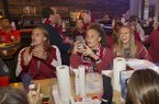 Arkansas soccer players Lindsey Mayo, Cameron Carter and Ellie Breden celebrate during an NCAA Tournament selection show watch party Monday, Nov. 7, 2016, at Sassy's Barbecue & Grille in Fayetteville.