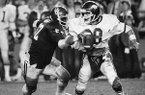 Arkansas quarterback Ron Calcagni (18) is pressured by an Oklahoma defender during the Orange Bowl on Jan. 2, 1978, in Miami. (AP Photo/Phil Sandlin)