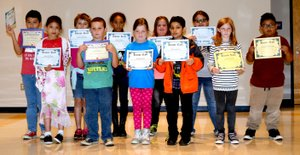Photo by Mike Eckels Third grade students at Decatur Northside Elementary show off their honor roll certificates which they received during an assembly Oct. 20.