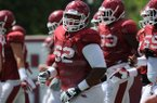 Arkansas offensive lineman Johnny Gibson (62) runs Tuesday, Aug. 11, 2015, during practice at the university's practice field in Fayetteville.