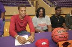 El Dorado senior Daniel Gafford, left, signs his national letter of intent Wednesday, Nov. 9, 2016, in El Dorado.