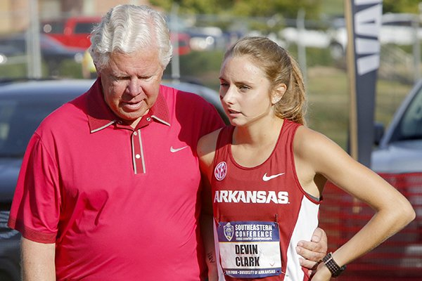 Arkansas coach Lance Harter, left, talks with sophomore Devin Clark prior to the start of the SEC Cross Country Championship on Friday, Oct. 28, 2016, in Fayetteville.