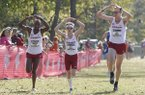 Frankline Tonui (from left), Alex George and Jack Bruce approach the finish line Friday, November 11, 2016, at the NCAA South Regional at the Agri Park course in Fayetteville. The Razorbacks won the overall team title.